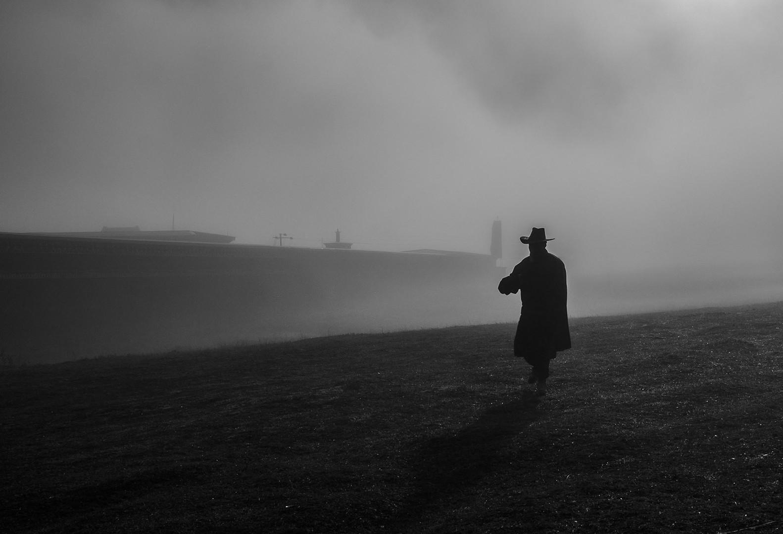 man in long black coat