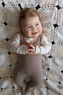 Nenad_Ristic In mommy's jumpsuit on daddy's blanket...